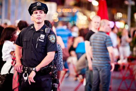 NEW YORK CITY - JULY 2: An unidentified NYPD Police Officer on Times square on July, 2011 in Manhattan, New York City.