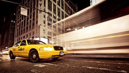 NEW YORK - JULY 2: Standind yellow taxicab in front of world famous department store Macys on July 2, 2011 in Manhattan, New York, USA. This flagship Macys store was founded in 1902 Editorial