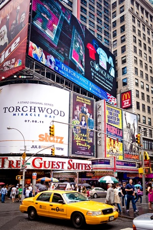 NEW YORK CITY - JULY 2: Times Square featured with Broadway Theaters and animated LED signs is a symbol of New York City and the United States, July 2, 2011 in Manhattan, New York City. Stock Photo - 12059690