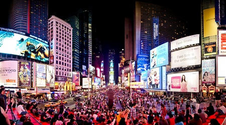times square: NEW YORK CITY - JULY 1: Panoramic shot of Times Square, featured with Broadway Theaters and animated LED signs, is a symbol of New York City and the United States, July 1, 2011 in Manhattan, New York City. Editorial