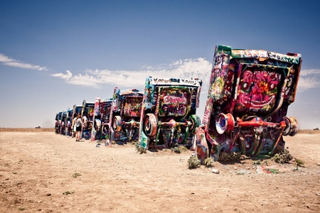 AMARILLO, TEXAS - JULY 10: Famous art installation of the old Cadillac cars on July 10, 2011 at Cadillac Ranch near Amarillo, Texas. It was created in 1974 by Chip Lord, Hudson Marquez and Doug Michels, who were a part of the art group Ant Farm
