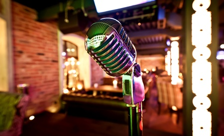 Retro microphone on stage photo