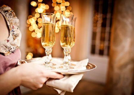 Full glasses of champagne on tray photo