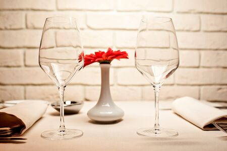 Empty glasses set in restaurant photo