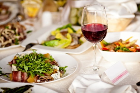 wine and food: Glasses set with drinks in restaurant Stock Photo