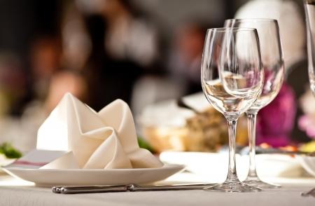 banquets: Empty glasses set in restaurant