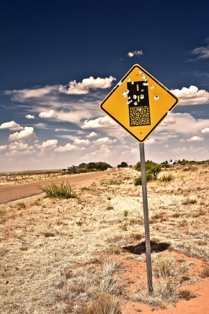 outlaws: Road sign full of shotgun holes found at New Mexico, USA