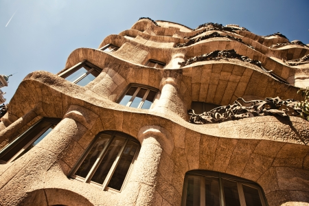 BARCELONA, SPAIN - OCTOBER 4: Casa Mila or La Pedrera on October 4, 2012 in Barcelona, Spain. This famous building was designed by Antoni Gaudi and is one of the most visited of the city. Editorial