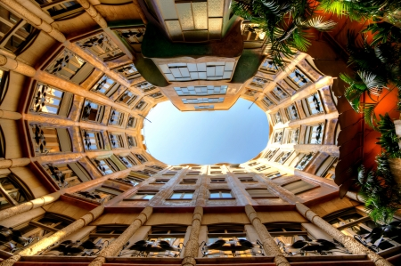 antoni: BARCELONA, SPAIN - OCTOBER 4: Casa Mila or La Pedrera on October 4, 2012 in Barcelona, Spain. This famous building was designed by Antoni Gaudi and is one of the most visited of the city. Editorial
