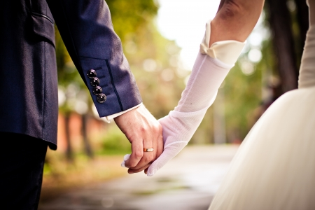 groom and bride: Bride and groom holding hands