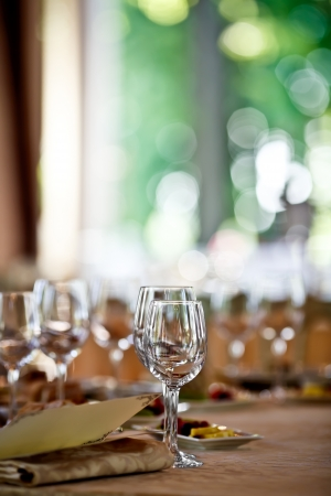 dinner table: Empty glasses set in restaurant