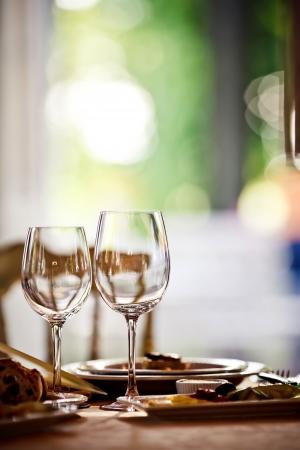 dinner table: Empty glasses set in restaurant