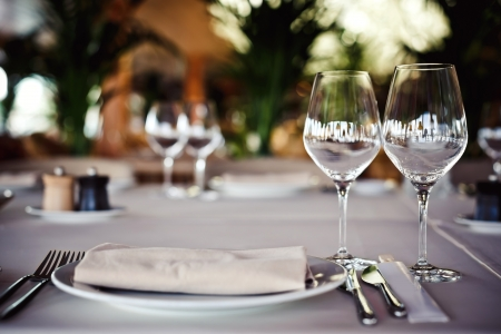 fine dining: Empty glasses set in restaurant