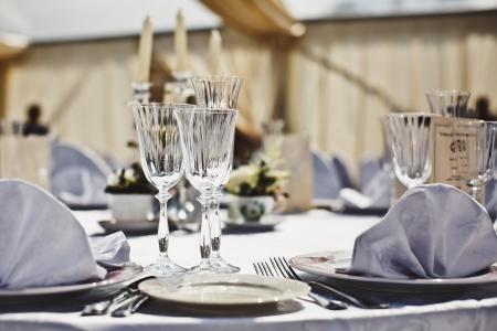 fine silver: Empty glasses set in restaurant. Part of interior