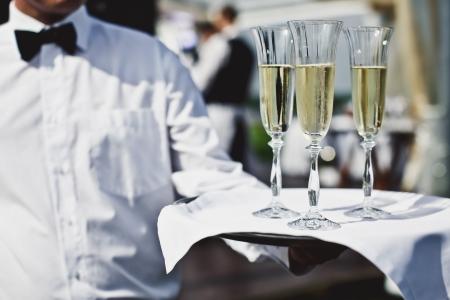Waiter serving champagne at festive event photo