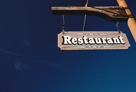 Restaurant Sign With Blue Sky photo