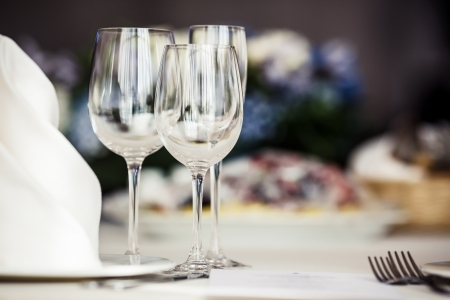 empty glass: Empty glasses set in restaurant. Part of interior