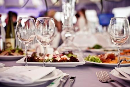 fine dining: Empty glasses set in restaurant. Part of interior