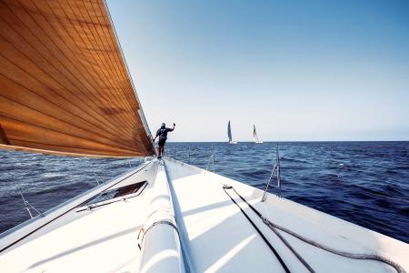 Sailing ship yachts with white sails in a row Zdjęcie Seryjne