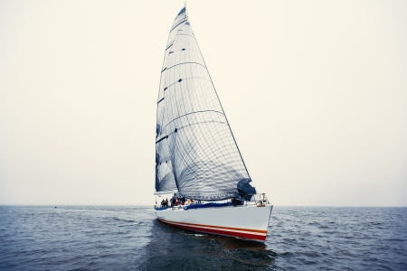 sailing crew: Sailing ship yachts with white sails in a row Editorial