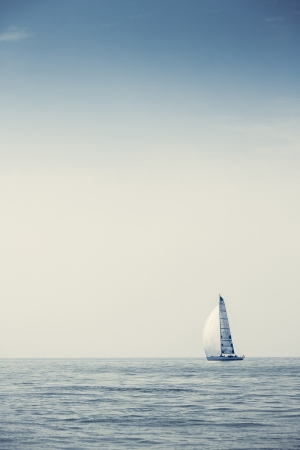 Sailing ship yachts with white sails in a row Stock Photo