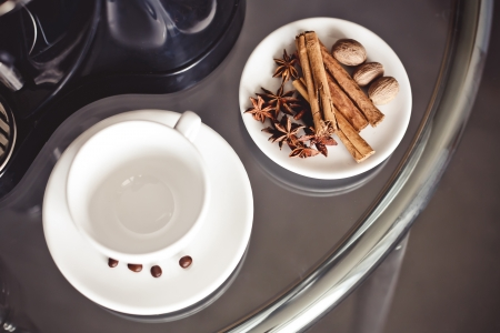 Spices for coffee on white plate (cinnamon, anise star and nutmeg) Stock Photo - 22167411