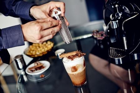 handle bars:    Preparation of latte macchiato with cinnamon and anise stars