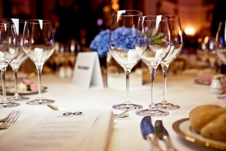 banquet: Empty glasses set in restaurant. Part of interior