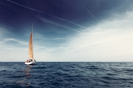 ship bow: Sailing ship yachts with white sails in the open sea