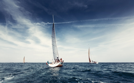 boat crew: Sailing ship yachts with white sails in the open sea