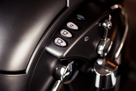 Close-up of coffee machine buttons photo