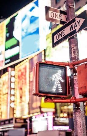 Keep walking New York traffic sign with illuminated and blurred background photo