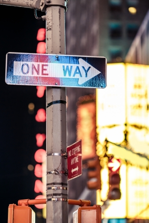 One way New York traffic sign with illuminated and blurred background photo