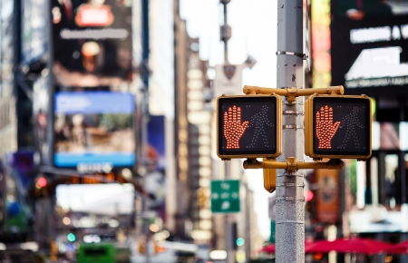 Dont walk New York traffic sign with illuminated and blurred background photo