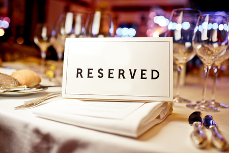 Reserved sign on a table in restaurant photo