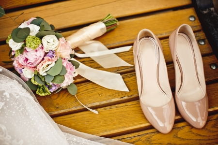 Close up of wedding bouquet and bride shoes photo