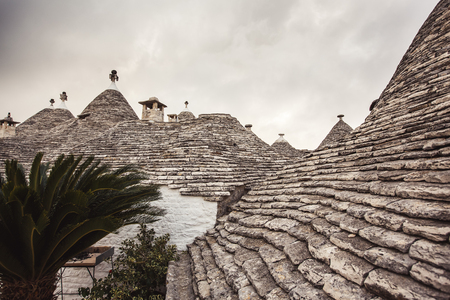 trulli: Typical trulli houses with conical roof  Stock Photo