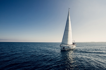 sailing crew: Sailing ship yachts with white sails in the open sea