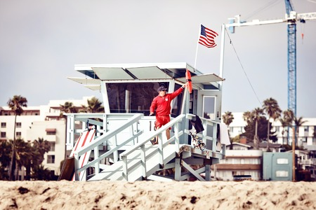 LOS ANGELES, USA - JULY 24: Lifeguard tower on Santa Monica State Beach on July 24, 2012 in Santa Monica, California. Santa Monica has 3.5 miles of well-maintained California beach locations and enjoys on average 340 days of sunshine