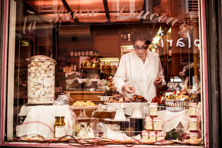 laxative: SAINT TROPEZ, FRANCE - OCTOBER 18, 2013: Woman in the candy shop on October 18, 2013, Saint Tropez, France