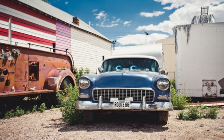 rusty car: SELIGMAN - August 3: The Historic Seligman Sundries on August 3, 2012 in Seligman, Arizona. Built in 1904, today, the Seligman Sundries is Seligman's only gourmet coffee bar and gift shop. Editorial