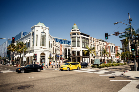 BEVERLY HILLS, USA - AUGUST 7: View of Rodeo Drive during sunny day on August 7, 2012 in Beverly Hills. Rodeo Drive is a shopping district famous for designer label and haute couture fashion
