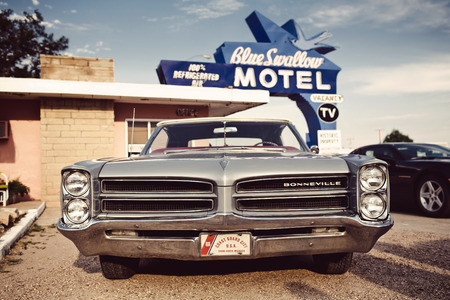 TUCUMCARI, NM - AUGUST 13: Blue Swallow Motel on Historic Route 66 on August 13, 2012 in Tucumcari, NM. The Blue Swallow has been serving travelers along the Mother Road since 1939.