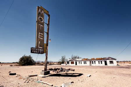 Hotel sign ruin along historic Route 66 in the middle of Californias vast Mojave desert. Stock Photo