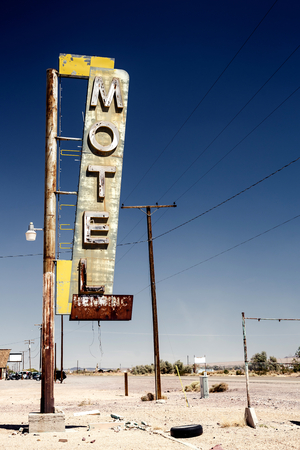 Hotel sign ruin along historic Route 66 in the middle of California's vast Mojave desert.