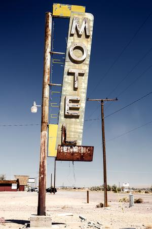 desert highway: Hotel sign ruin along historic Route 66 in the middle of Californias vast Mojave desert. Stock Photo