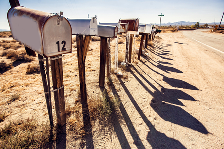 Grunge mail boxes in a row at Arizona desert USA photo