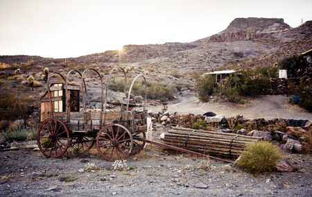 ghost town: Old time horse drawn wagon in the desert town of Calico . An 1890s silver boom town in the mojave desert.