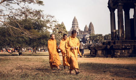 subsequently: ANGKOR WAT,CAMBODIA - DECEMBER 31: Unidentified Buddhist monks in Angkor Wat complex on Cambodia on December 31,2013. Angkor Wat was first a Hindu, then subsequently, a Buddhist temple complex.