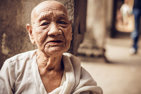 subsequently: ANGKOR WAT,CAMBODIA - DECEMBER 31: Unidentified Buddhist monk in Angkor Wat complex on Cambodia on December 31,2013. Angkor Wat was first a Hindu, then subsequently, a Buddhist temple complex.